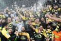 The Hurricanes celebrate their victory after the Super Rugby final against the Lions of South Africa. Photo: AFP