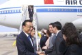 China's Premier Li Keqiang (left) and his wife, Cheng Hong, (second left) arrive in New York on Sunday ahead of the 71st session of the United Nations General Assembly. Photo: Xinhua