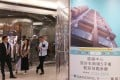 Potential buyers wait outside the sales office of One Prestige at Mira Mall in Tsim Sha Tsui on Tuesday. Photo: K. Y. Cheng