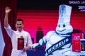 Master chef of T'ang Court Justin Tan reacts after the announcement the restaurant has been awarded three Michelin stars in the French company's first guide to Shanghai dining. Photo: AFP