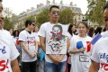 A members of the Chinese commmunity in Paris holds a placard during a demonstration on September 4, 2016 in Paris, following the death of Zhang Chaolin and also calling for greater security measures. Photo: AFP