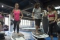 Cherilyn Chow (right), managing director and instructor at Surfset Fitness Hong Kong, puts Post writer Elaine Yau (left) and others through their paces. Photos: Antony Dickson