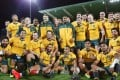 Australia pose with the Puma Cup after winning the Rugby Championship match against Argentina. Photo: EPA