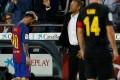 Barcelona's Lionel Messi leaves the pitch next to coach Luis Enrique. Photo: Reuters