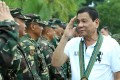 Philippine President Rodrigo Duterte saluting troops during a visit to a military camp in Compostela Valley. Photo: EPA