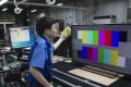A worker inspects a Panasonic Corp. Viera 4K liquid crystal display (LCD) television on the production line of the company's Manufacturing Innovation Center in Utsunomiya, Tochigi Prefecture, Japan. Photo: Bloomberg