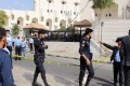 Jordanian police corner off the area where prominent Jordanian writer Nahed Hattar was shot dead outside a court in Amman. Photo: AFP