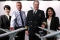 (From left) Cathay Pacific inflight service manager Monica Tong, aircraft project manager Tony Britton, general manager of operations and former chief pilot of the Boeing 747 Mark Hoey and inflight services standards and safety manager Le Le Ng, pay fond tribute to the retiring aircraft. Photo: Jonathan Wong