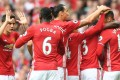 Manchester United players celebrate after Chris Smalling's goal during the 4-1 win over Leicester on Saturday. Photo: AFP