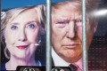 Large images of Democratic nominee Hillary Clinton and Republican nominee Donald Trump are seen on a CNN vehicle, behind a security fence at Hofstra University, in Hempsted, New York. The university is the site of the first Presidential debate. Photo: AFP