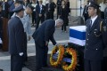 Israeli Prime Minister Benjamin Netanyahu places a wreath by the coffin of former Israeli President Shimon Peres at the Knesset, Israel's Parliament, in Jerusalem. Photo: AP