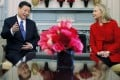 Then US secretary of state Hillary Clinton chats with then vice-president Xi Jinping at the State Department in Washington in February 2012. Photo: AP