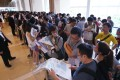 Flushed by easy money provided by finance companies that are upending the HKMA's lending caps, property buyers throng a sales room. Photo: Felix Wong.