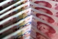 In July 2005 Beijing abolished the yuan's peg to the US dollar, kicking off the float era. Photo: Reuters