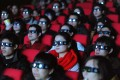 Chinese movie-goers watching a 3D film. Box office revenue growth has slowed dramatically from last year in the mainland. Photo: AFP