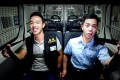 A screenshot from the video shows officers singing in a police van. Photo: SCMP Pictures