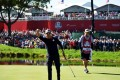 Zach Johnson of the United States reacts after making a putt on the 16th green to win the match during morning foursome matches of the 2016 Ryder Cup at Hazeltine National Golf Club. Photo: AFP