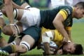 Australia's Sean McMahon is tackled by South Africa's Francois Louw. Photo: AP