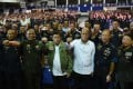 Philippine President Rodrigo Duterte, centre, wearing an air force jacket given to him as a gift, poses with defence secretary Delfin Lorenzana, fourth right, and military chief General Ricardo Visaya, third left. Photo: AFP