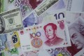 The yuan's induction into the IMF's elite currency club has had no immediate impact on trading. Photo: Reuters
