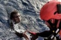 A migrant is rescued from the Mediterranean Sea by a member of Proactiva Open Arms NGO some 20 nautical miles north of Libya. Photo: AFP