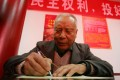 A man fills out his ballot before voting in a district election in Beijing in November 2006. Photo: AP