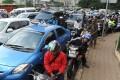 Commuters drive in heavy traffic in Jakarta. Photo: AFP