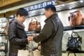 Chinese tourists shop at Harrods department store in London. Bargain hunters aplenty have been flocking to the Britain capital during the golden week holiday, say travel agents. Photo: AFP