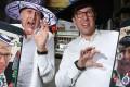 Allan Zeman (left) and Jonathan Zeman show off their new app as they get into the Halloween spirit in Lan Kwai Fong. Sam Tsang
