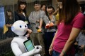 """A """"Pepper"""" robot performs during a press conference organised by Cathay Financial Holdings in Taipei on Thursday. Photo: AFP"""