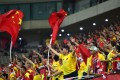 Chinese fans wave national flags during the 2018 World Cup qualifying football match between South Korea and China in Seoul on September 1, 2016. / AFP PHOTO / JUNG YEON-JE