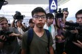 Demosisto activist Joshua Wong arriving at the Hong Kong International Airport after being detained by Thai authorities and denied entry to Thailand. Photo: Sam Tsang