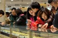Gold draws the crowds at a shopping mall in Beijing in February 2011. China's economy has enjoyed the effects of three generations' savings being released at once. Photo: Xinhua