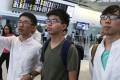 Joshua Wong (centre) arrives at Hong Kong International after being denied entry into Thailand. Photo: Sam Tsang
