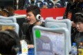 Players compete during e-sports festival held in Wuhan, Hubei province. Photo: Xinhua
