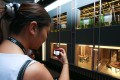 A woman checks flat models for Henderson Land's Park One development in Sham Shui Po. Photo: Edward Wong