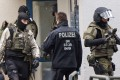 Police officers leave an apartment after detonations in the city of Chemnitz. Photo: AP