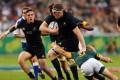 South African scrum half Faf de Klerk tackles All Blacks lock Brodie Retallick. Photo: AFP
