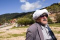 Arif Demaj with a traditional Rugova white head-kerchief in the village of Boge in western Kosovo. Photo: AFP
