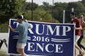 Students carry a Trump-Pence sign at Longwood University in Farmville, Virginia. Photo: AP