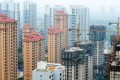 China's property sector has been in the grip of a buying frenzy since the second half of 2015, prompting many municipal governments to impose cooling measures. Photo: Xinhua
