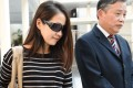 Yvonne Seah (left), who worked formerly for Swiss private bank BSI, leaves with her lawyer from the State court in Singapore. Photo: AFP