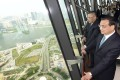 Premier Li Keqiang (right) and Macau Chief Executive Fernando Chui enjoy the view from an observation deck on the Macau Tower. Photo: SCMP Pictures