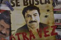 """A poster with the face of Mexican drug lord Joaquin """"El Chapo"""" Guzman, reading """"Wanted, Again"""", is displayed at a news-stand in one Mexico City's major bus terminals in 2015. Photo: AFP"""