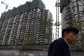 Apartments under construction in Beijing, where property market policies were tightened on September 30 in a bid to dampen rising prices. Photo: AFP