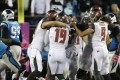 Tampa Bay Buccaneers players celebrate with kicker Roberto Aguayo (19) after his game-winning field goal against the Carolina Panthers in the second half of an NFL football game in Charlotte, N.C., Monday, Oct. 10, 2016. (AP Photo/Bob Leverone)