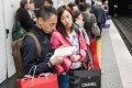 Chinese tourists laden with shopping bags in Paris. Photo: SCMP
