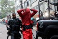 A police officer arrests a suspected drug dealer after a shootout during a police operation at Pavao-Pavaozinho slum in Rio de Janeiro on Monday. Photo: Reuters