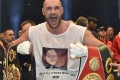"""FILE - In this Nov. 29, 2015 file photo, Britain's new world champion Tyson Fury, celebrates with the WBA, IBF, WBO and IBO belts after winning the world heavyweight title fight against Ukraine's Wladimir Klitschko in Duesseldorf, western Germany. Fury has vacated his WBO and WBA world titles to concentrate on his treatment and recovery from drug use and other personal issues. Fury's promotors released a statement early Thursday, Oct. 13, 2016, confirming the decision. It comes in the wake of his second withdrawal from a rematch with Wladimir Klitschko after being declared """"medically unfit"""" and following his admitted bingeing on cocaine and alcohol. (AP Photo/Martin Meissner, File)"""