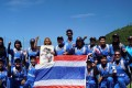 Thailand's women players hold up a picture of their king after beating Nepal in the ICC World Cup Asia qualifiers.